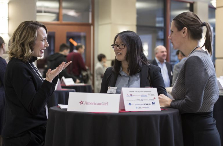 3 students network at the annual Corporate Connections Social